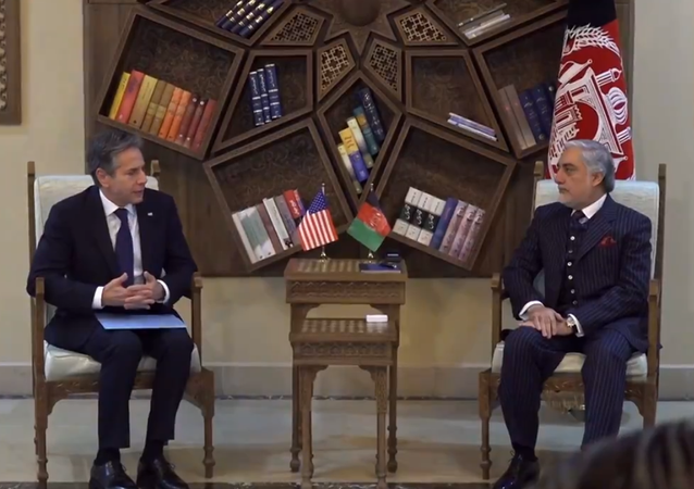 Secretary of State Antony Blinken (left) meets with Afghan chairman of the high council for national reconciliation during a surprise visit to Kabul, Afghanistan on Thursday, 15 April, 2021.