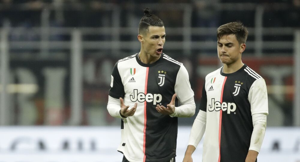 Juventus' Cristiano Ronaldo, left, speaks with Juventus' Paulo Dybala at the end of the Italian Cup soccer match between AC Milan and Juventus at the San Siro stadium, in Milan, Italy, Thursday, 13 February 2020