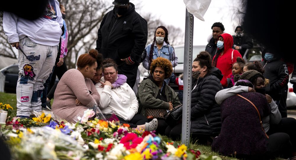 Members of Daunte Wright's family visit a memorial site near the place he was killed on April 14, 2021 in Brooklyn Center, Minnesota.