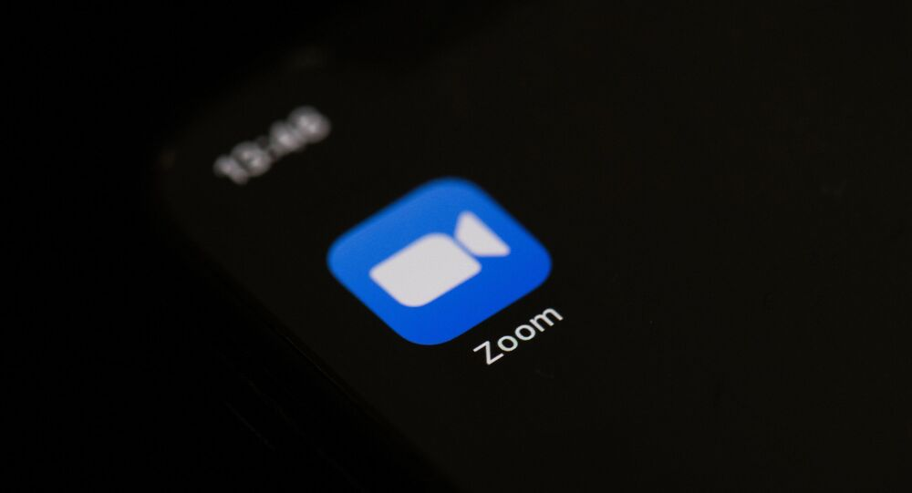 This illustration picture taken on May 27, 2020 in Paris shows the logo of the social network  application Zoom on the screen of a phone