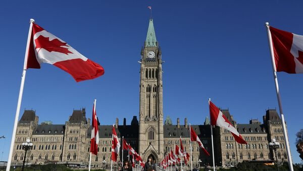 Canadian flags line the walkway in front of the Parliament in Ottawa, Ontario, October 2, 2017 - Sputnik International