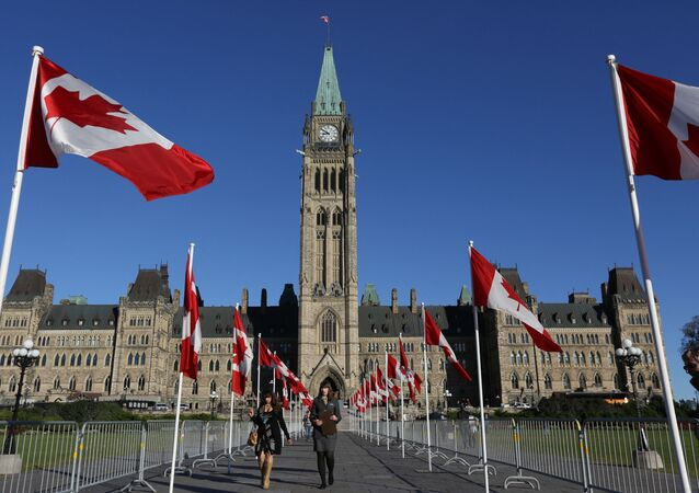 Canadian flags line the walkway in front of the Parliament in Ottawa, Ontario, October 2, 2017