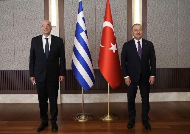 Turkish Foreign Minister Mevlut Cavusoglu meets with his Greek counterpart Nikos Dendias in Ankara, Turkey, 15 April 2021.