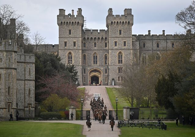 Members of the Kings Troop Royal Horse Artillery ride their horses away from Windsor Castle in Windsor, west of London, on April 15, 2021, following the April 9 death of Britain's Prince Philip, Duke of Edinburgh, at the age of 99.