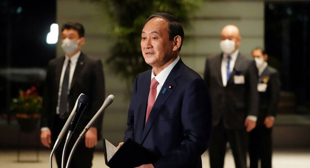 Japanese Prime Minister Yoshihide Suga speaks to media after announcing that Tokyo, Kyoto and Okinawa will have pre-emergency status under a new prevention law during a government task force meeting at the prime minister's office, Tokyo, Japan, April 9, 2021.