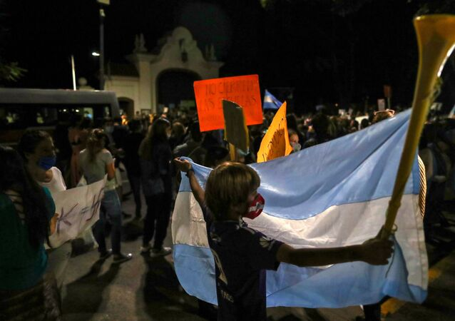 Demonstrators take part in a protest outside the Olivos Presidential residence against new restrictions and the closure of schools imposed in the city and Buenos Aires' province amid a rise in coronavirus disease (COVID-19) cases, in Buenos Aires, Argentina, April 15, 2021.