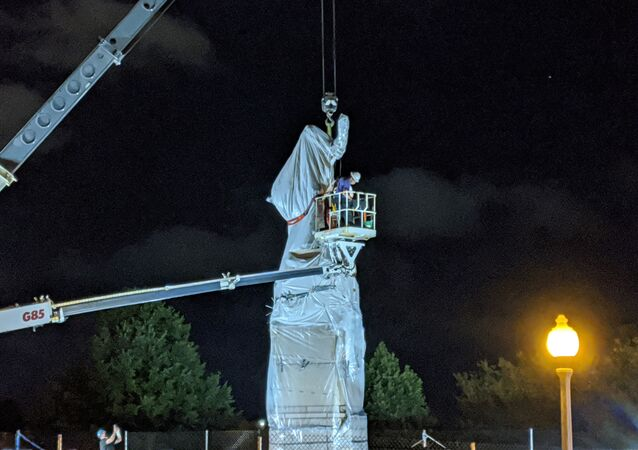A statue of Christopher Columbus at Grant Park in Chicago is removed early on July 24, 2020.