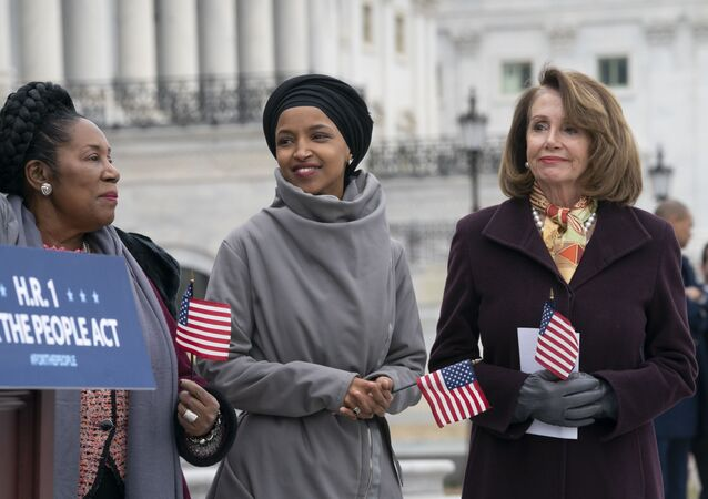 Rep. Ilhan Omar, D-Minn., smiles as she stands between Rep. Sheila Jackson Lee, D-Texas, left, and Speaker of the House Nancy Pelosi, D-Calif., as Democrats rally outside the Capitol ahead of passage of H.R. 1, The For the People Act, a bill which aims to expand voting rights and strengthen ethics rules, in Washington, Friday, March 8, 2019.