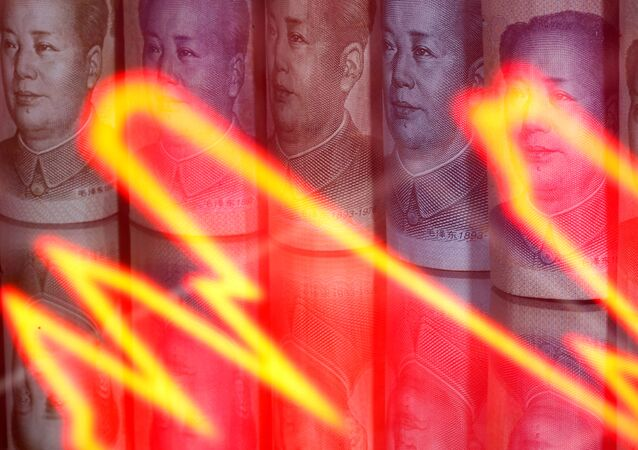 Chinese yuan banknotes are seen behind illuminated stock graph in this illustration taken February 10, 2020