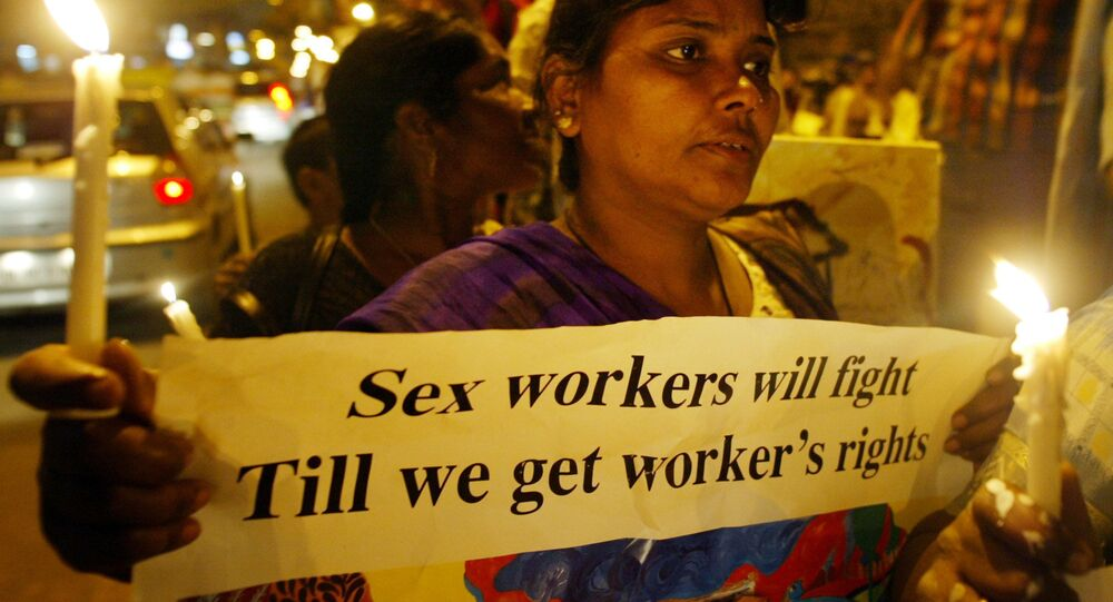 Activists of the Darbar Mahila Samanwaya Committee, a forum of 65,000 sex workers based in West Bengal, publicize a rally scheduled for March 8, at a red light area in New Delhi, India, Friday, March 3, 2006