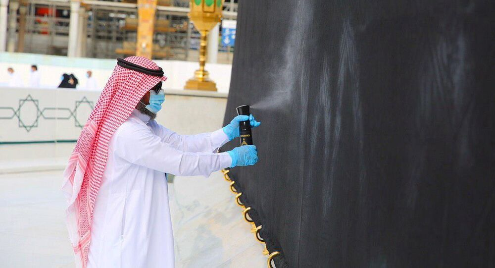 Officials from the office of the President General of the two Holy Mosque Affairs clean and scent the Kabaa in the Grand Mosque, in the holy city of Mecca, Saudi Arabia, April 14, 2021