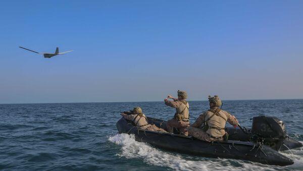 A reconnaissance Marine launches an RQ-20 Puma aboard a combat rubber raiding craft, May 24, 2020 - Sputnik International