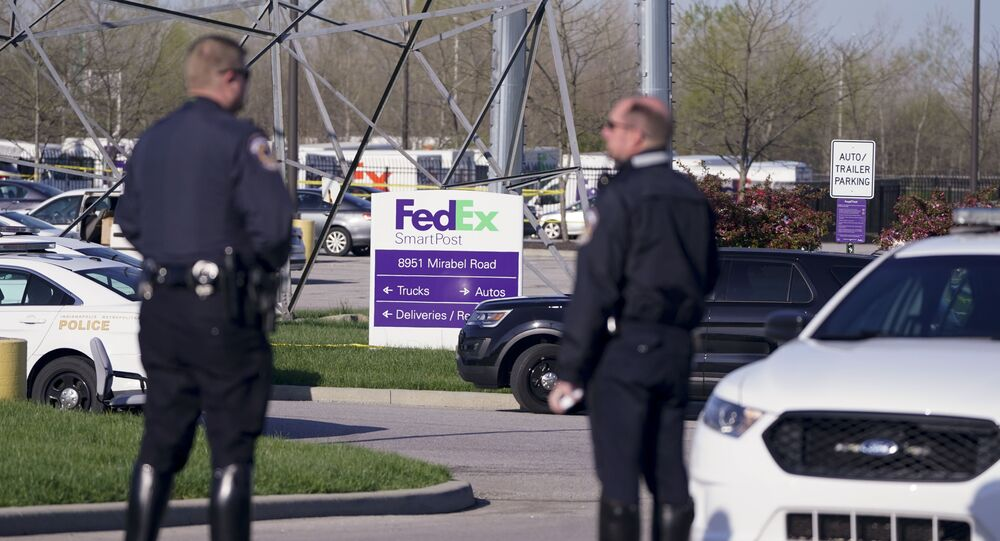 Police stand near the scene where multiple people were shot at the FedEx Ground facility early Friday morning, April 16, 2021, in Indianapolis. A gunman killed eight people and wounded several others before apparently taking his own life in a late-night attack at a FedEx facility near the Indianapolis airport, police said, in the latest in a spate of mass shootings in the United States after a relative lull during the pandemic