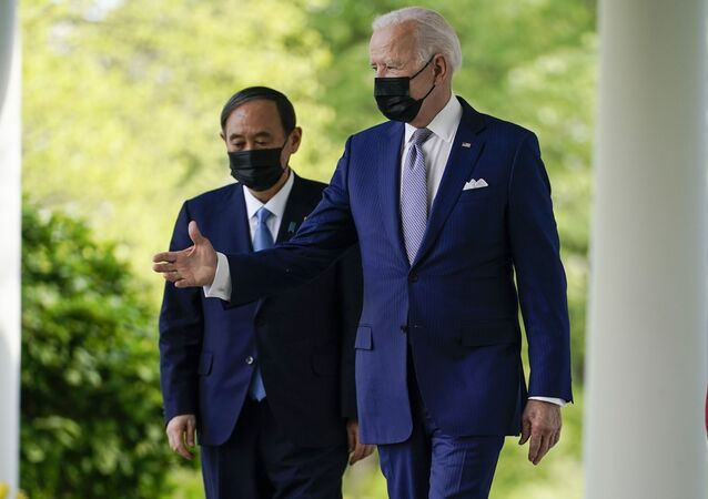 President Joe Biden, accompanied by Japanese Prime Minister Yoshihide Suga, walks from the Oval Office to speak at a news conference in the Rose Garden of the White House, Friday, April 16, 2021, in Washington.