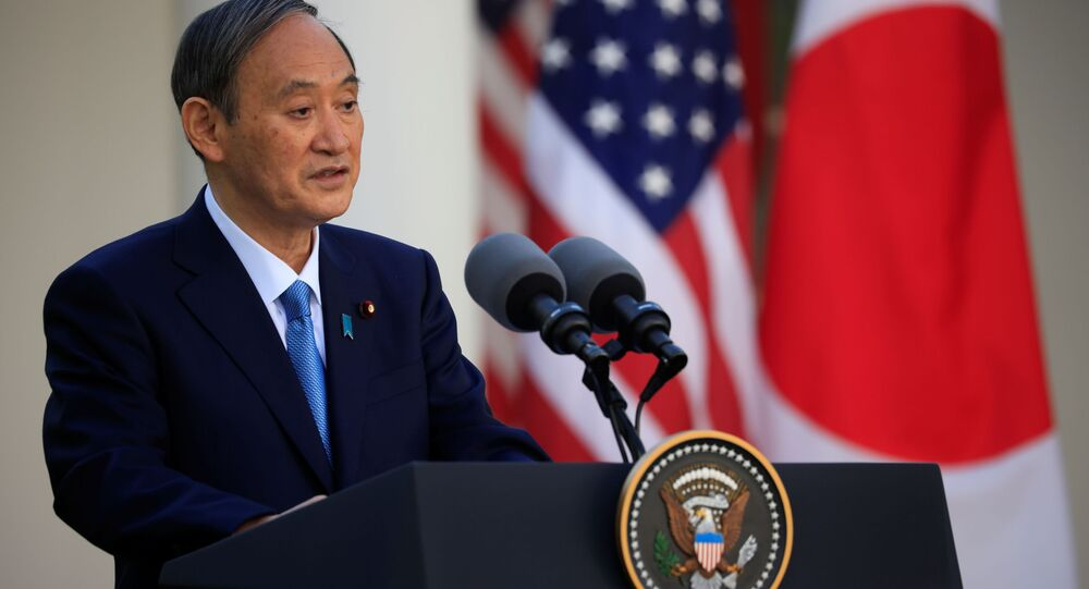 Japan's Prime Minister Yoshihide Suga addresses a joint news conference with U.S. President Joe Biden in the Rose Garden at the White House in Washington, U.S., April 16, 2021.