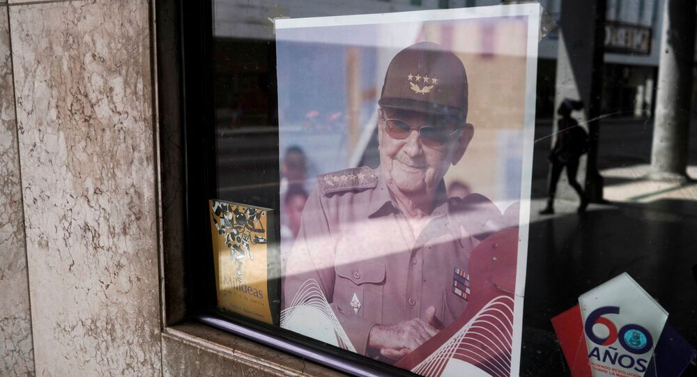 A picture of former Cuban President Raul Castro is displayed in the window of a state building in Havana, Cuba, April 11, 2021. Picture taken April 11, 2021.