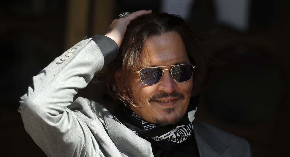 In this file photo dated Tuesday, July 28, 2020, US Actor Johnny Depp arrives at the High Court in London during his case against News Group Newspapers over a story published about his former wife Amber Heard, which branded him a 'wife beater'