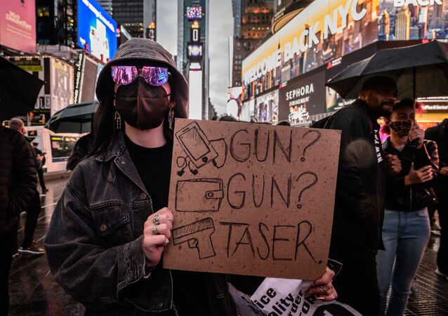 Protesters and activists attend a vigil for Daunte Wright and others killed during police confrontations, at Times Square in New York city on April 16, 2021.