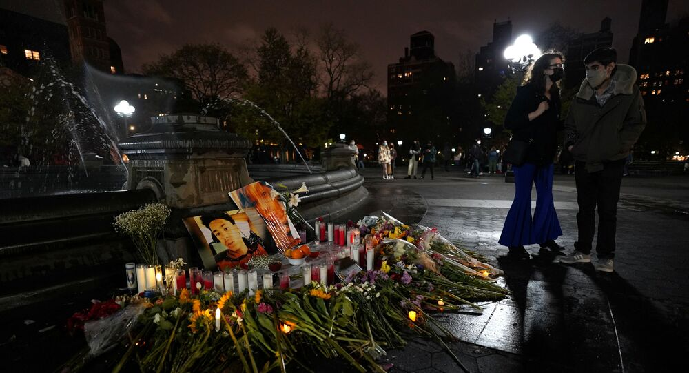 People look at a memorial in Washington Square Park for Daunte Wright and for Dominique Lucious in New York City, U.S., April 16, 2021.