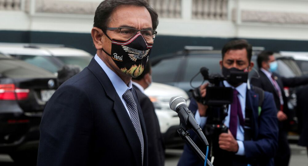 Peru's President Martin Vizcarra addresses the media outside Congress as he faces a second impeachment trial over corruption allegations, in Lima, Peru November 9, 2020.