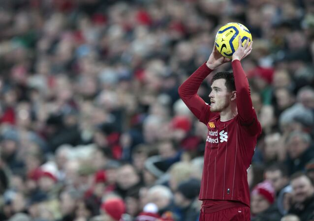 Liverpool's Andrew Robertson takes a throw in during the English Premier League soccer match between Liverpool and Brighton at Anfield Stadium, Liverpool, England, Saturday, Nov. 30, 2019