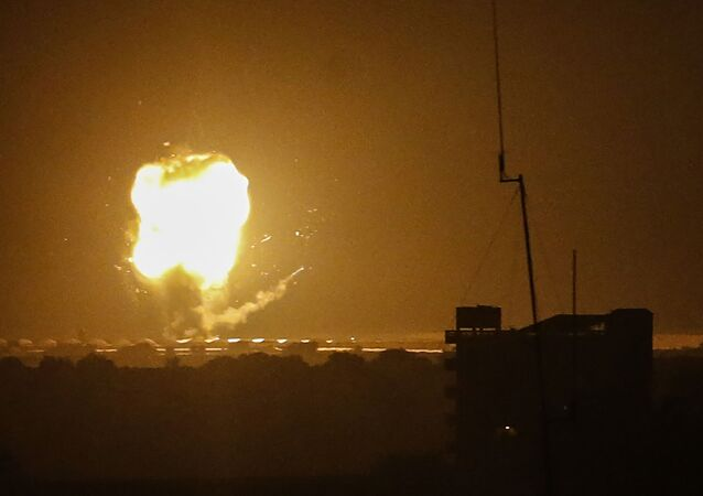 A picture taken in Rafah in the southern Gaza Strip, on April 17, 2021, shows an explosion following an airstrike by Israel. - The Israeli military said it had conducted airstrikes against targets in the Gaza Strip following a rocket attack from the Palestinian enclave, in the second such exchange in as many days. (Photo by SAID KHATIB / AFP)