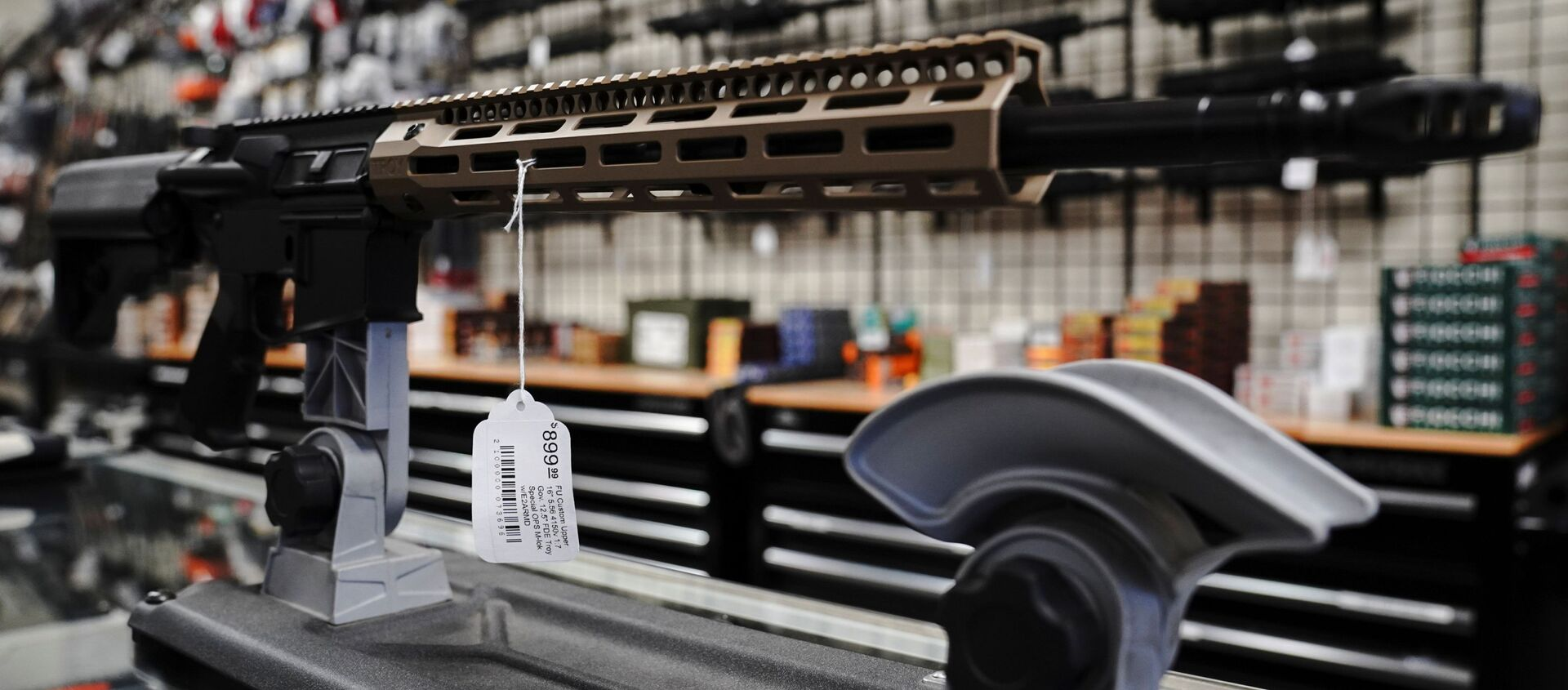 An FU custom upper receiver for an AR-15 style rifle is displayed for sale at Firearms Unknown, a gun store in Oceanside, California, U.S., April 12, 2021.  REUTERS/Bing Guan - Sputnik International, 1920, 22.07.2021