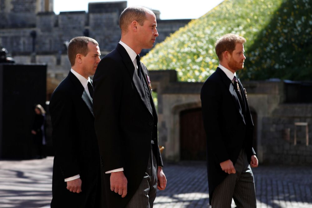 ritain's Prince William, Duke of Cambridge and Prince Harry, Duke of Sussex walk behind the hearse on the grounds of Windsor Castle during the funeral of Britain's Prince Philip, husband of Queen Elizabeth, who died at the age of 99, in Windsor, Britain