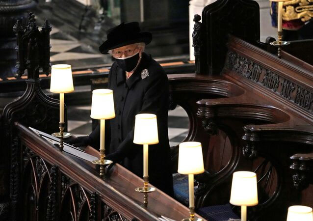Britain's Queen Elizabeth is seen during the funeral of Britain's Prince Philip, husband of Queen Elizabeth, who died at the age of 99, at St George's Chapel, in Windsor, Britain, April 17, 2021. Yui Mok/Pool via REUTERS     TPX IMAGES OF THE DAY