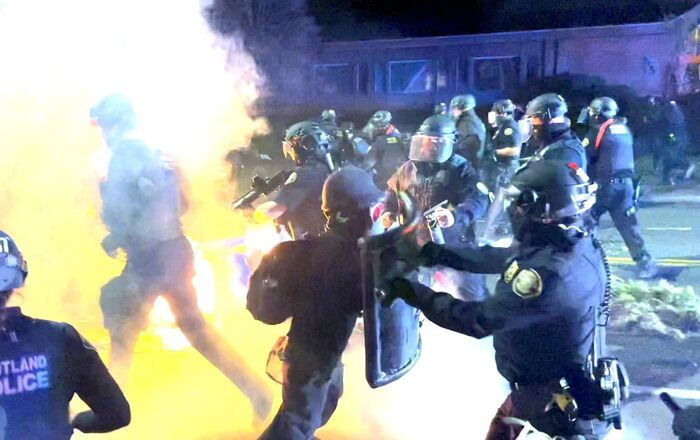 A demonstrator confronts a police officers during clashes, following the fatal police shooting of 20-year-old Black man Daunte Wright in Minnesota, April 12, 2021 in this still image obtained from a social media video on April 13, 2021.