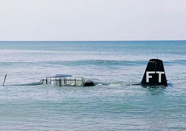 A photo of the TBM Avenger after an emergency landing on the beach shore on April 17, 2021.