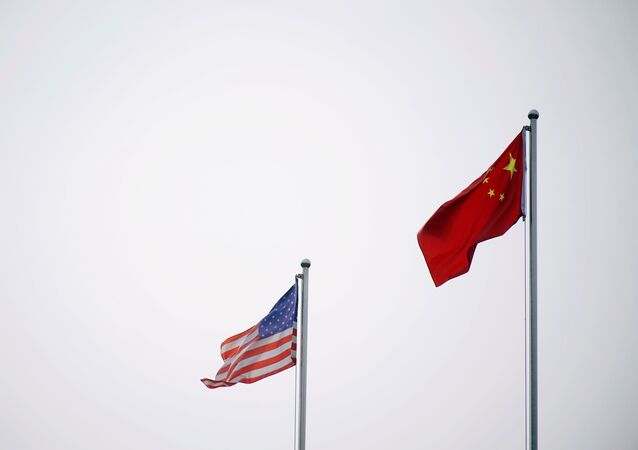 Chinese and U.S. flags flutter outside a company building in Shanghai, China April 14, 2021.