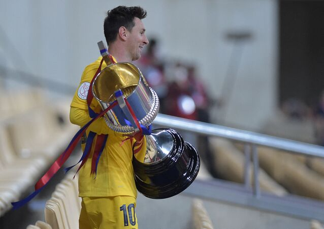 Barcelona's Argentinian forward Lionel Messi holds the trophy at the end of the Spanish Copa del Rey