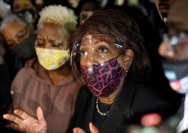 U.S. Rep. Maxine Waters speaks to the press after standing with protesters in front of the Brooklyn Center police department, as protests continue days after former police officer Kim Potter fatally shot Daunte Wright, in Brooklyn Center, Minnesota, U.S. April 17, 2021. REUTERS/Octavio Jones