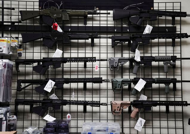 FILE PHOTO: AR-15 style rifles are displayed for sale at Firearms Unknown, a gun store in Oceanside, California, U.S., April 12, 2021. REUTERS/Bing Guan/File Photo