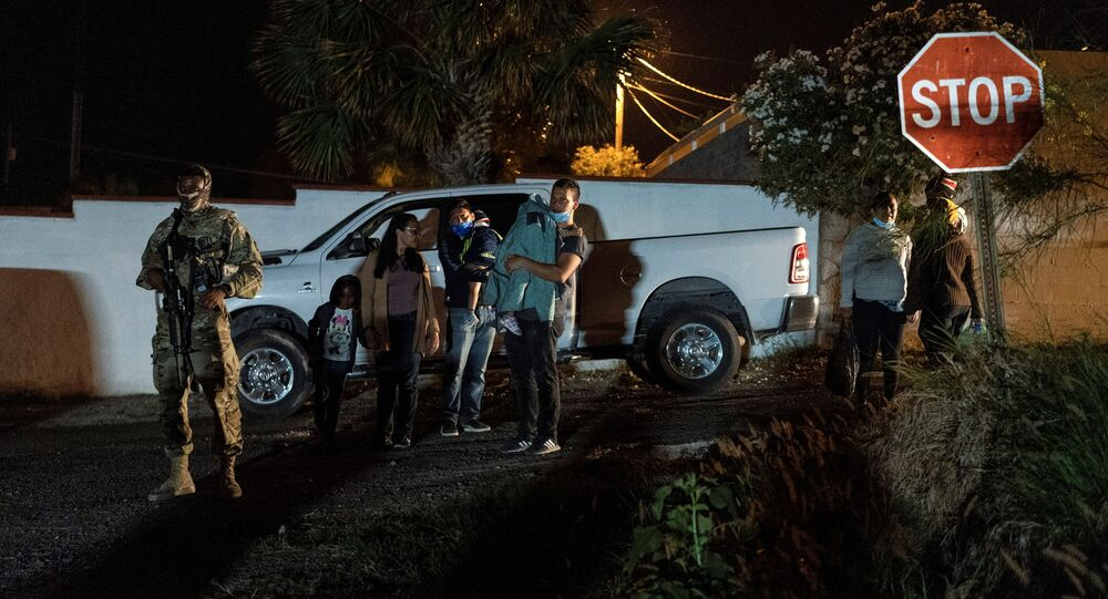 Asylum-seeking migrants' families wait to be transported by the U.S. Border Patrol after crossing the Rio Grande river into the United States from Mexico, in Roma, Texas, U.S. April 17, 2021.