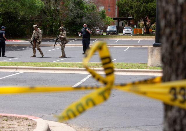 Law enforcement personnel investigate at the scene of a deadly shooting at an apartment complex in Austin, Texas, U.S., April 18, 2021.