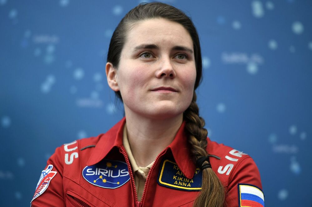 Russian cosmonaut Anna Kikina addresses a press conference on the ground-base simulation of a SIRIUS-17 Moon mission.