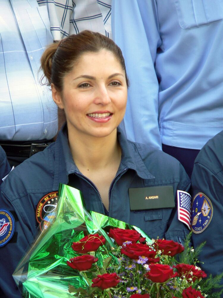 Iranian-American spaceflight participant Anousheh Ansari participates in the traditional flag-raising ceremony at the Cosmonaut Hotel in Baikonur, Kazakhstan on 5 September 2006.