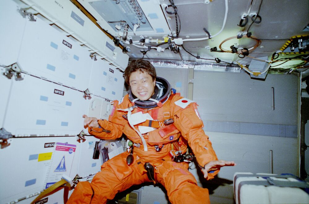 STS-65 payload specialist Chiaki Mukai is photographed on the Columbia's middeck wearing her orange launch and entry suit (LES) after launching into orbit.