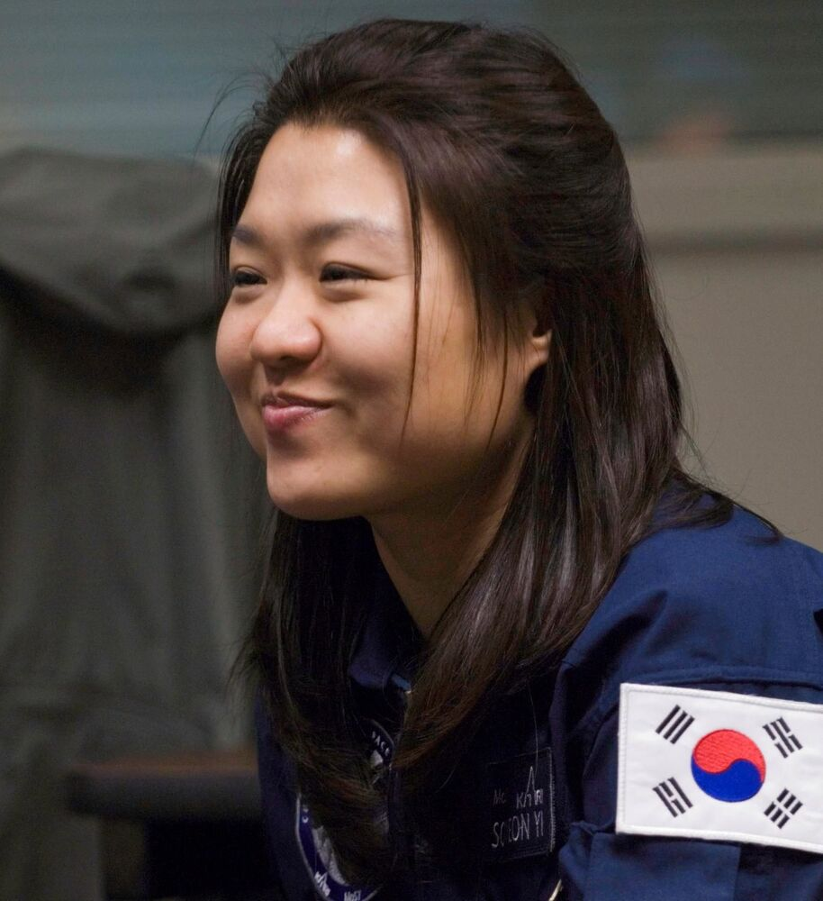 Backup spaceflight participant Yi So-yeon listens to a news reporter's question for male spaceflight participant Ko San (out of frame) of South Korea during an Expedition 17 press briefing on 15 January 2008 at the Johnson Space Centre.