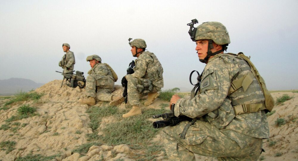 U.S Army Soldiers from Alpha Company, 2nd Battalion, 508th Parachute Infantry Regiment move into position to support Afghan National police who are moving in to apprehend a suspect during a cordon and search of Pana, Afghanistan, June 9, 2007