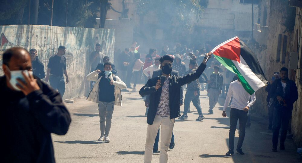 Palestinian demonstrators take part in a protest marking Land Day, in Sebastia near Nablus in the West Bank, 30 March 2021