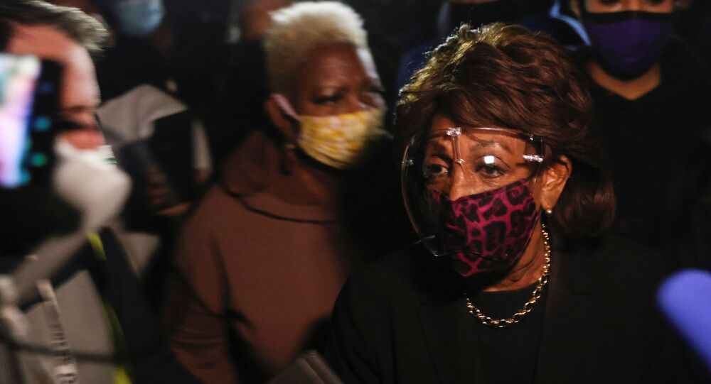 U.S. Representative Maxine Waters (D-CA) is surrounded by members of the media as she makes an appearance outside the Brooklyn Center Police Department, as protests continue days after Daunte Wright was shot and killed by a police officer, in Brooklyn Center, Minnesota, U.S. April 17, 2021. REUTERS/Leah Millis
