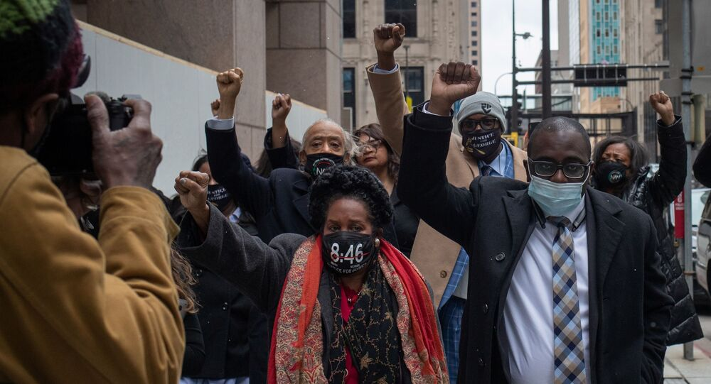 Philonise Floyd, brother of George Floyd, raises his fist as he arrives with family members, Reverend Al Sharpton, Congresswoman Sheila Jackson Lee and attorney Adner Marcelin to the Hennepin County Government Center for closing arguments in the murder trial of former police officer Derek Chauvin, who is facing murder charges in the death of George Floyd, in Minneapolis, Minnesota, U.S., 19 April 2021.