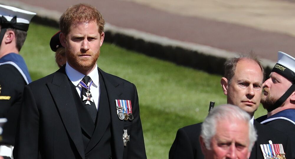 Britain's Prince Charles, Britain's Prince Harry, Duke of Sussex and Britain's Prince Edward, Earl of Wessex, follow the hearse, a specially modified Land Rover, during the funeral of Britain's Prince Philip, husband of Queen Elizabeth, who died at the age of 99, on the grounds of Windsor Castle in Windsor, Britain, 17 April 2021