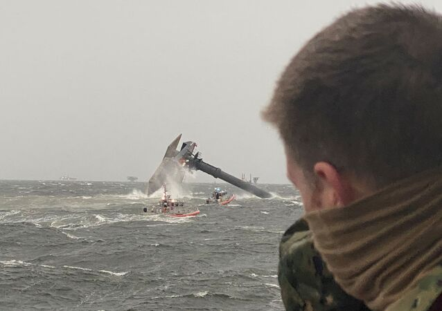 Coast Guard Station Grand Isle boatcrews head toward a capsized 175-foot commerical lift boat while searching for people in the water 8 miles (about 13 km) south of Grand Isle, Louisiana, U.S. April 13, 2021