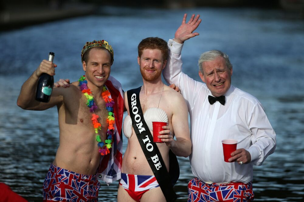 Lookalikes of Britain's Prince William, Duke of Cambridge (L), Britain's Prince Harry (C) and Britain's Prince Charles, Prince of Wales (R) pose for a picture in London