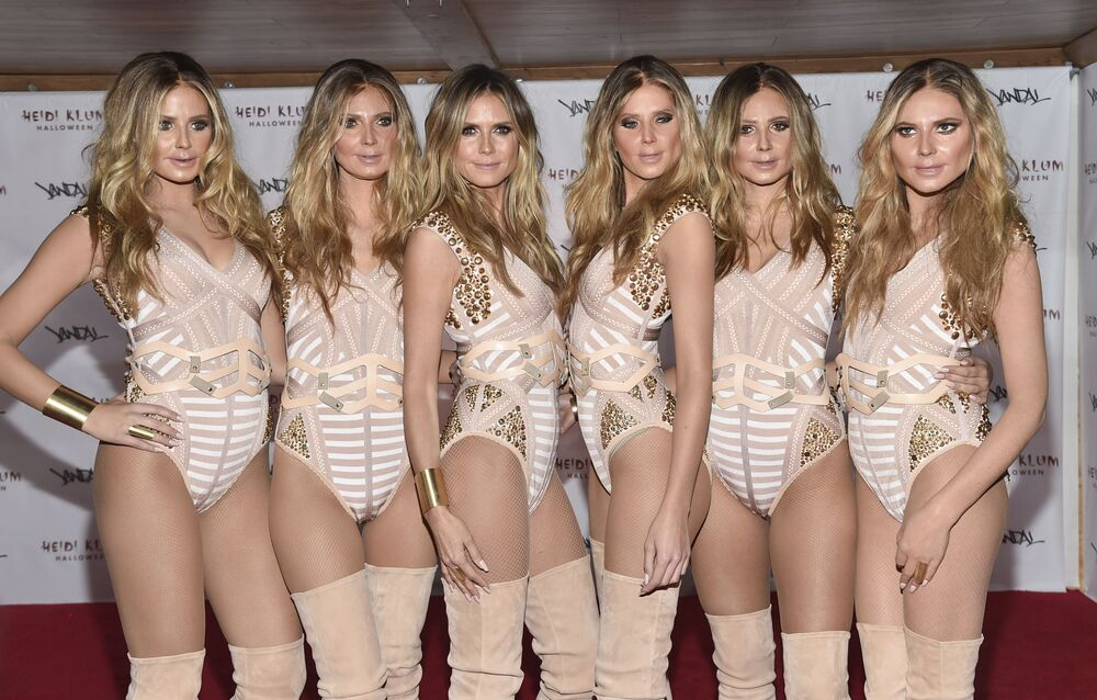 Model and television personality Heidi Klum, third from left, poses with Heidi Clones at her 17th Annual Halloween Party at Vandal on Monday, Oct. 31, 2016, in New York.