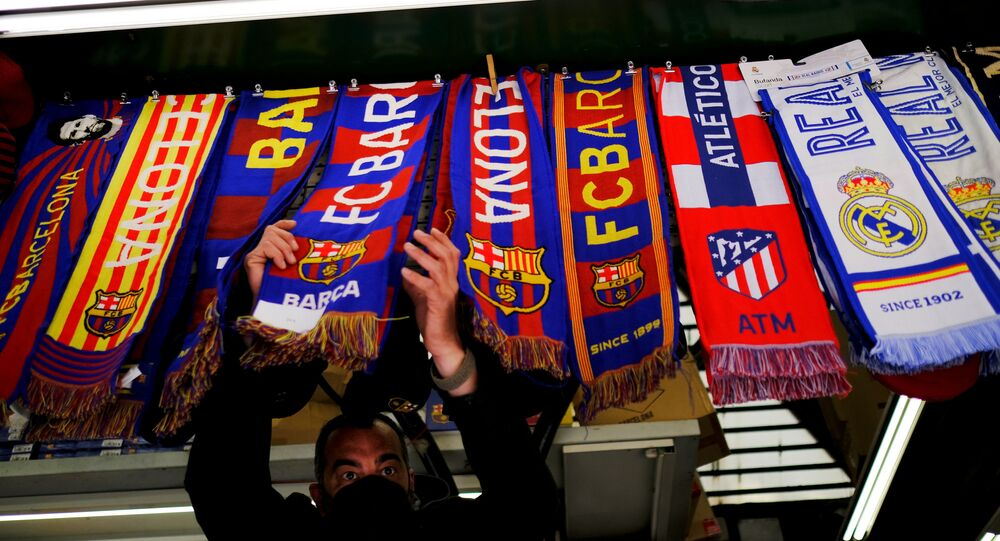 Soccer Football - FC Barcelona, Atletico Madrid and Real Madrid scarves are displayed inside a store at Las Ramblas as twelve of Europe's top football clubs launch a breakaway Super League - Barcelona, Spain - April 19, 2021